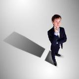 Επιχειρηματίας με τη σκιά ως σύμβολο χρημάτων Στοκ εικόνα με δικαίωμα ελεύθερης χρήσης