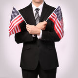 Επιχειρηματίας με τις αμερικανικές σημαίες Στοκ Φωτογραφίες