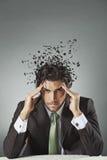 Επιχειρηματίας με το διεσπαρμένο μυαλό Στοκ Φωτογραφία
