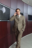 Επιχειρηματίας με το κινητό τηλέφωνο χ Στοκ Εικόνες