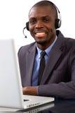 Επιχειρηματίας με το μικρόφωνο κασκών Στοκ Εικόνα