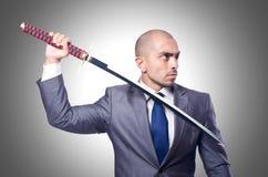 Επιχειρηματίας με το ξίφος Στοκ Φωτογραφία
