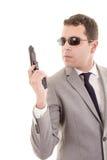 Επιχειρηματίας με το πυροβόλο όπλο που απομονώνεται στο λευκό Στοκ Εικόνες