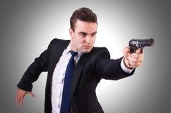 Επιχειρηματίας με το πυροβόλο όπλο Στοκ Φωτογραφία
