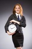 Επιχειρηματίας με το ρολόι που είναι αργά Στοκ Εικόνες