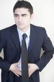 Επιχειρηματίας με το στομαχόπονο στοκ φωτογραφία