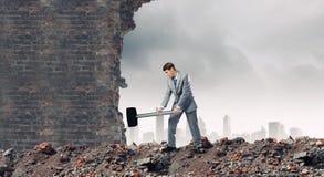 Επιχειρηματίας με το σφυρί Στοκ Εικόνες