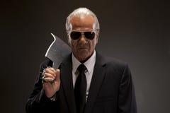 Επιχειρηματίας με το τέμνον μαχαίρι Στοκ Εικόνες