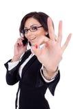Επιχειρηματίας με το τηλέφωνο και την εντάξει χειρονομία Στοκ Φωτογραφίες