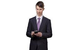Επιχειρηματίας με το τηλέφωνο στα χέρια του Στοκ εικόνες με δικαίωμα ελεύθερης χρήσης