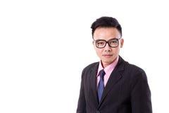 Επιχειρηματίας με eyeglasses που εξετάζει σας Στοκ Φωτογραφία