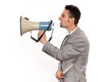 Επιχειρηματίας με megaphone και το μεγάλο μαχαίρι Στοκ φωτογραφία με δικαίωμα ελεύθερης χρήσης