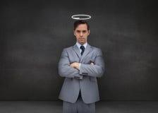 Επιχειρηματίας που αντιπροσωπεύει έναν άγγελο Στοκ Εικόνα
