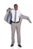 Επιχειρηματίας που βάζει το σακάκι κοστουμιών Στοκ εικόνα με δικαίωμα ελεύθερης χρήσης