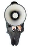 Επιχειρηματίας που δίνει τις οδηγίες με megaphone Στοκ Εικόνες