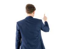 Επιχειρηματίας που δείχνει κάτι με το δάχτυλό του Στοκ Φωτογραφία