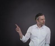 Επιχειρηματίας που δείχνει σε κάτι Στοκ Φωτογραφίες