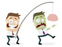 Επιχειρηματίας που δελεάζει zombie με τον εγκέφαλο σε μια ράβδο Στοκ Φωτογραφία