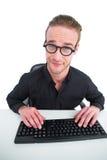Επιχειρηματίας που κάνει ένα πρόσωπο λειτουργώντας στο γραφείο Στοκ Εικόνες