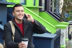 Επιχειρηματίας που καλεί τηλεφωνικώς από την πόρτα σπιτιών Στοκ Φωτογραφία