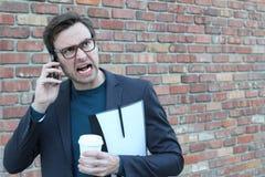 0 επιχειρηματίας που καλεί τηλεφωνικώς Στοκ Φωτογραφία
