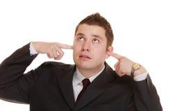 Επιχειρηματίας που καλύπτει τα αυτιά του, αστείες εκφράσεις Στοκ Φωτογραφίες