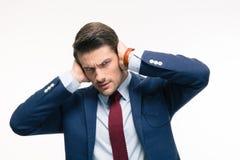 0 επιχειρηματίας που καλύπτει τα αυτιά του Στοκ Φωτογραφίες