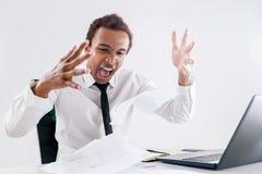 Επιχειρηματίας που κουράζεται μαύρος της γραφικής εργασίας Στοκ εικόνα με δικαίωμα ελεύθερης χρήσης