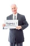 Επιχειρηματίας που κρατά έναν πίνακα μηνυμάτων με τις ευχαριστίες λέξεων κειμένων στοκ φωτογραφίες