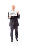 Επιχειρηματίας που κρατά έναν πίνακα μηνυμάτων με τις ευχαριστίες λέξεων κειμένων στοκ εικόνες με δικαίωμα ελεύθερης χρήσης