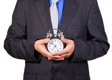 Επιχειρηματίας που κρατά ένα ρολόι Στοκ Εικόνα