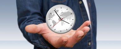 Επιχειρηματίας που κρατά ένα ρολόι στο χέρι του Στοκ Εικόνα