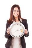 Επιχειρηματίας που κρατά ένα ρολόι Στοκ φωτογραφίες με δικαίωμα ελεύθερης χρήσης