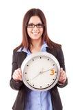 Επιχειρηματίας που κρατά ένα ρολόι Στοκ Φωτογραφία