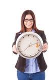Επιχειρηματίας που κρατά ένα ρολόι Στοκ Εικόνες