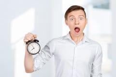 Επιχειρηματίας που κρατά ένα ρολόι Στοκ εικόνες με δικαίωμα ελεύθερης χρήσης