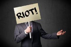 Επιχειρηματίας που κρατά ένα σημάδι διαμαρτυρίας Στοκ Εικόνα