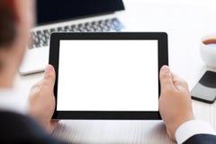 Επιχειρηματίας που κρατά μια ταμπλέτα με την απομονωμένη οθόνη στο γραφείο Στοκ φωτογραφία με δικαίωμα ελεύθερης χρήσης