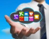 Επιχειρηματίας που κρατά τα ζωηρόχρωμα app εικονίδια στο μαύρο σύννεφο με τον ουρανό Στοκ Εικόνα
