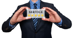 Επιχειρηματίας που κρατά την άσπρη κάρτα με την υπηρεσία πέντε σημάδι αστεριών, Whi Στοκ φωτογραφία με δικαίωμα ελεύθερης χρήσης