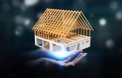 Επιχειρηματίας που κρατά το τρισδιάστατο σπίτι σχεδίων απόδοσης ατελές στο εκτάριό του Στοκ εικόνα με δικαίωμα ελεύθερης χρήσης