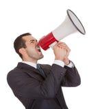 Επιχειρηματίας που κραυγάζει megaphone Στοκ Φωτογραφία