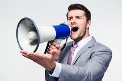 Επιχειρηματίας που κραυγάζει megaphone Στοκ Φωτογραφίες