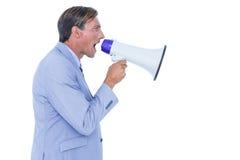 Επιχειρηματίας που μιλά μέσω megaphone Στοκ Φωτογραφίες