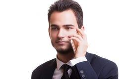 Επιχειρηματίας που μιλά στο τηλέφωνο που απομονώνεται στο άσπρο υπόβαθρο Στοκ εικόνες με δικαίωμα ελεύθερης χρήσης