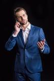 Επιχειρηματίας που μιλά στο smartphone Στοκ Φωτογραφίες