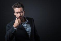 0 επιχειρηματίας που παρουσιάζει πυγμές Στοκ Εικόνα