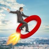 Επιχειρηματίας που πετά σε μηδέν σημάδι στοκ εικόνες