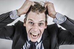 Επιχειρηματίας που πηγαίνει τρελλός Στοκ φωτογραφία με δικαίωμα ελεύθερης χρήσης