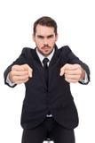 0 επιχειρηματίας που στέκεται με τις σφιγγμένες πυγμές Στοκ φωτογραφία με δικαίωμα ελεύθερης χρήσης